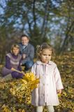 Little girl and parents Stock Image
