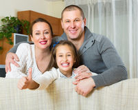 Little girl with parents posing Stock Photos