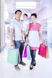 Little girl and parents shopping at mall Royalty Free Stock Photo