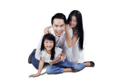 Little girl and parents smiling in studio Stock Photography