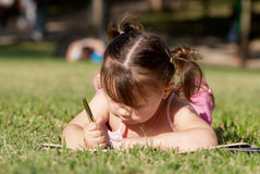 The little girl in park. Royalty Free Stock Images
