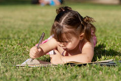The little girl in park Stock Photography