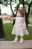Little girl in park. Little pretty girl in park stock photos