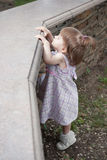 Little girl in park. Little pretty girl playing in park royalty free stock photography