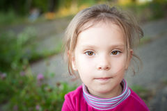Little girl in park Royalty Free Stock Image