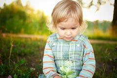 Little girl in park Stock Photo