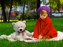 Little Girl in the Park. Little girl playing in the park in autumn Royalty Free Stock Images