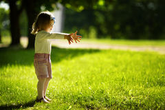 Little girl in park Stock Photo