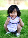 Little girl in a park stock photos