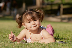 The little girl in park Stock Photos