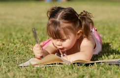 The little girl in park. Royalty Free Stock Image