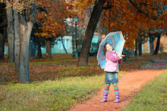 Little girl in park autumn season Stock Images