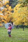 Little girl in park autumn season Royalty Free Stock Photo