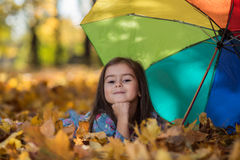 Little girl in the park in autumn Royalty Free Stock Image