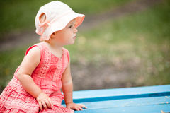 Little Girl on Park Bench Royalty Free Stock Photos