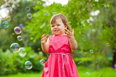 Little girl at park with bubbles Stock Photography