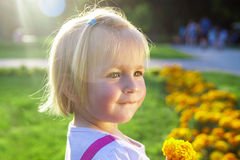 Little girl in a park Royalty Free Stock Photos