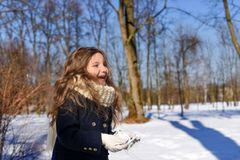 A little girl in a park with paper cranes. A positive photo representing a concept of coming spring - a laughnig little girl in a park with paper cranes Royalty Free Stock Image