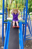 Little girl in park playground Royalty Free Stock Image