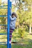 Little girl on park playground Royalty Free Stock Photos