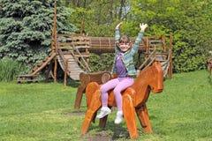 Little girl on park playground. Happy little girl on park playground Stock Photography