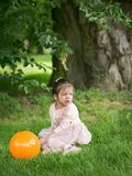 Little handsome girl in the park Stock Photo