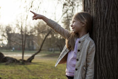 Little Girl In The Park Pointing Stock Image