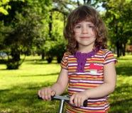 Little girl in park portrait Royalty Free Stock Photo