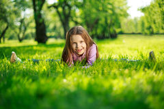 Little girl in park Stock Images