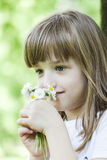 The little girl in the park smelling wildflowers Stock Images