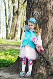 Little girl in park in the spring Royalty Free Stock Image