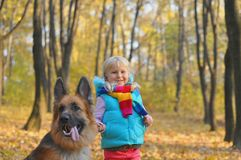 Little girl in the park their home with a dog.  Stock Photo