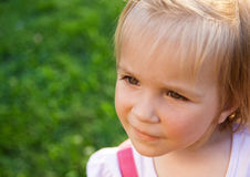 Little girl in a parkL Stock Images