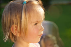 Little girl in a parkL Royalty Free Stock Photos