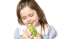 Little girl with Parrot. The beautiful little girl holds Parrot and smiles on white background close up Stock Photos