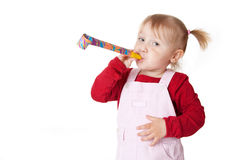 Little girl with party blower Royalty Free Stock Photo