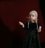 Little girl in party dress. Little girl standing and showing Royalty Free Stock Photo
