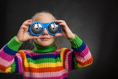 Little girl in party glasses Royalty Free Stock Images