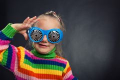 Little girl in party glasses Stock Photography