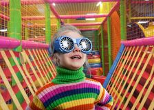 Little girl in party glasses Royalty Free Stock Photo