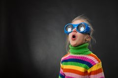 Little girl in party glasses Stock Photos