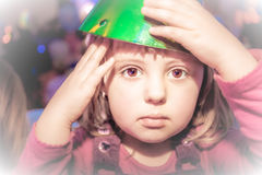 Little girl with a party hat Stock Image