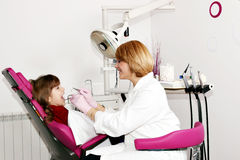 Little girl patient and dentist Stock Photography