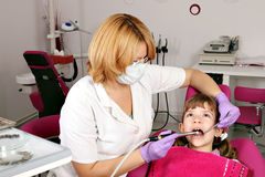 Little girl patient and dentist Stock Image