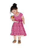 Little girl with peach Stock Photo