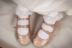 Little girl peach shoes with white socks Stock Photo