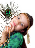 A little girl with a peacock feather Royalty Free Stock Image