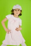 Little girl with peaked cap and summer dress Royalty Free Stock Photos