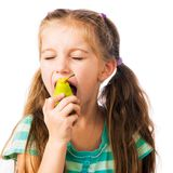 Little girl with  pear Royalty Free Stock Photo