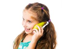 Little girl with  pear Royalty Free Stock Photography